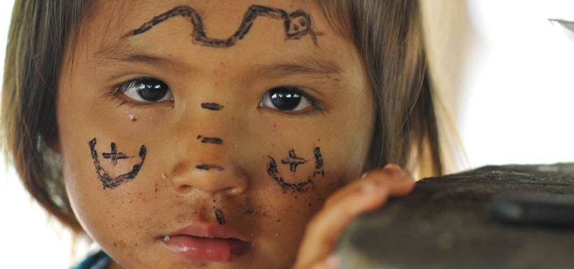 Achuar girl with painted face