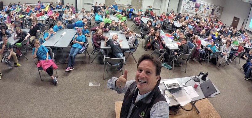 Dean taking a selfie with students at Battle of the Books