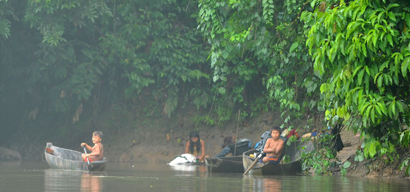 Family along banks of Amazon River